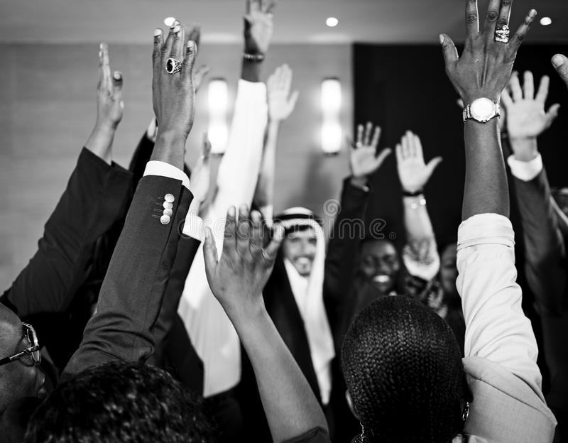 A Group of International Business People Are Raising Their Hands royalty free stock photos