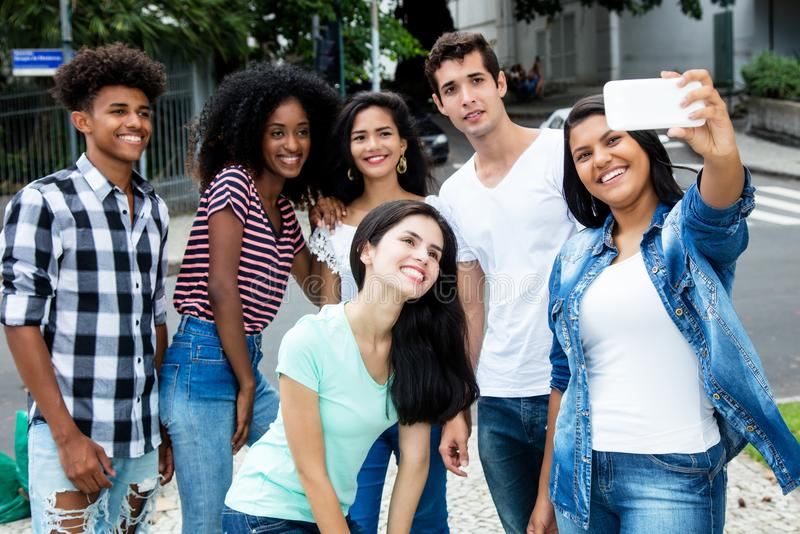 Group of international young adult people taking selfie. Outdoor in city stock photo
