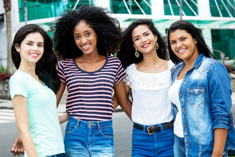 Group of international young adult women in city. Group of international young adult women outdoor in city royalty free stock photography