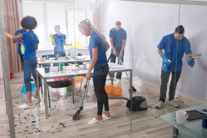 Group Of Janitors Cleaning Office stock photo