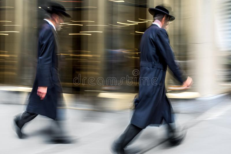 Group of jewish business people in the street stock photo