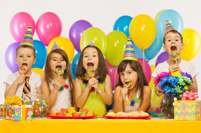 Group of joyful little kids having fun at birthday. Party. Holidays concept stock photography