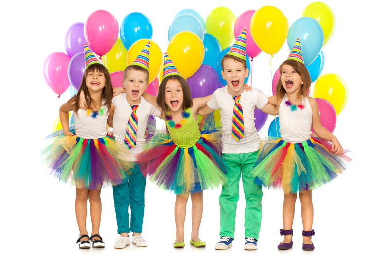 Group of joyful little kids having fun at birthday stock photos