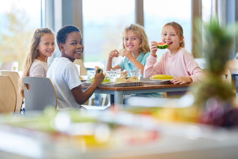 Group of kids as friends at lunch stock image