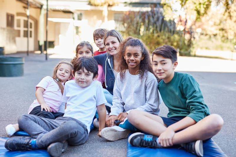 Group of kids as friends in summer camp stock photo