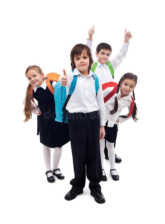 Group of kids with backpacks returning to school after vacation royalty free stock photography