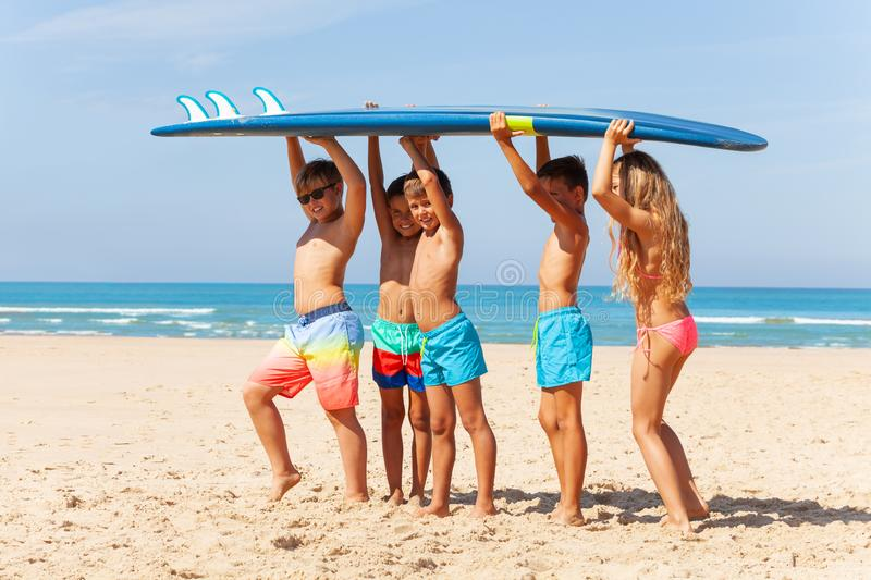 Kids portrait carry surfboard on the beach royalty free stock photography
