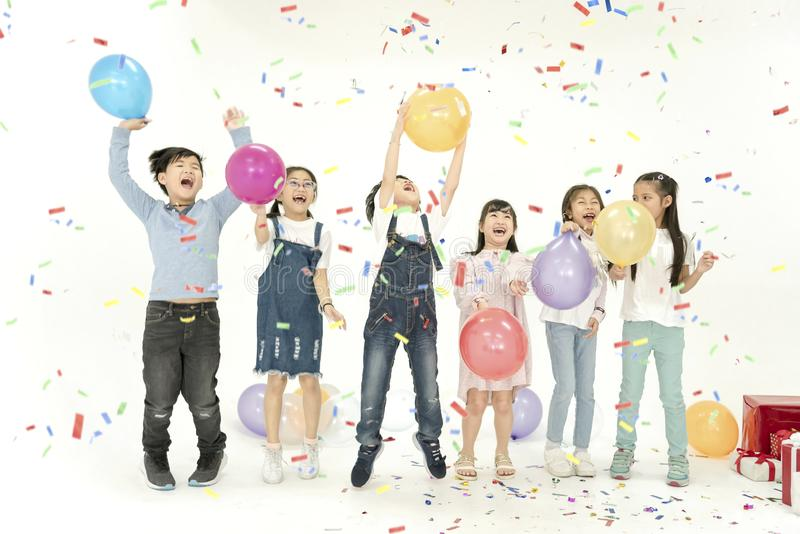 Group of kids celebrate christmas and happy new year party stock photos
