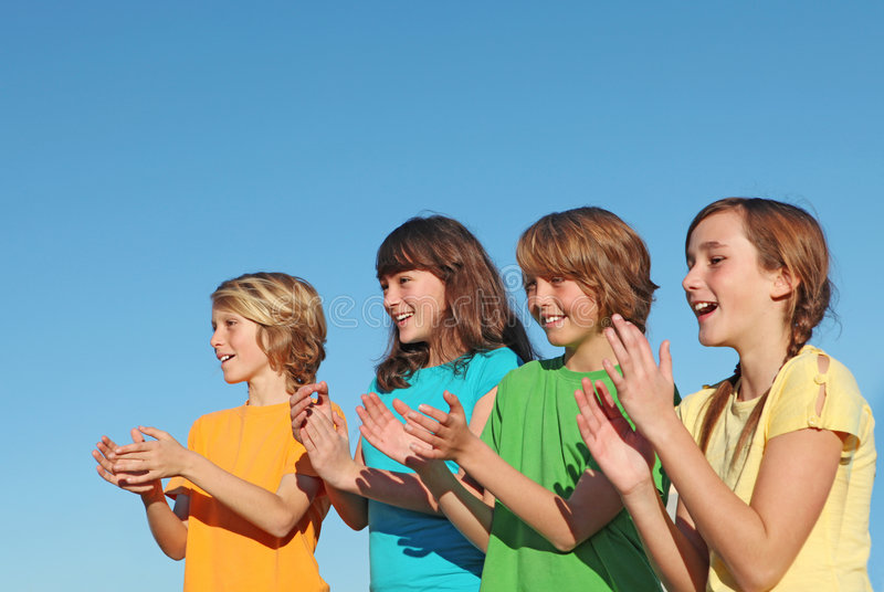 Group of kids clapping royalty free stock image