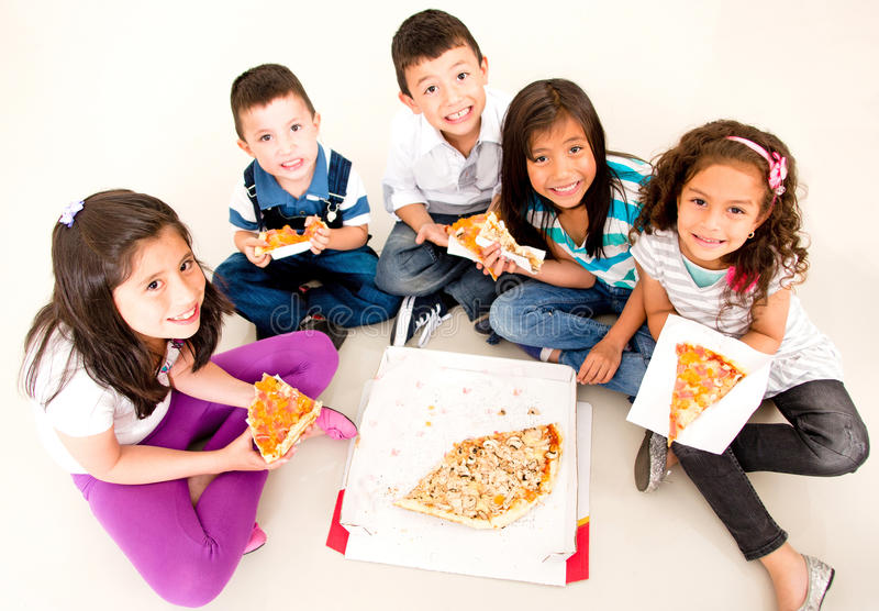 Download Group of kids eating pizza stock photo. Image of male - 27762622