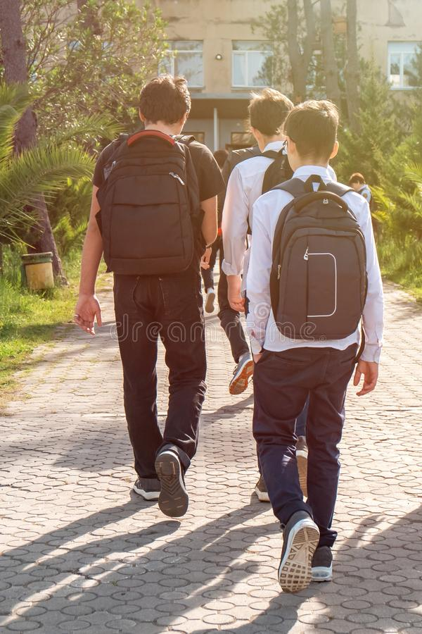 Group of kids going to school together, back to school stock photos