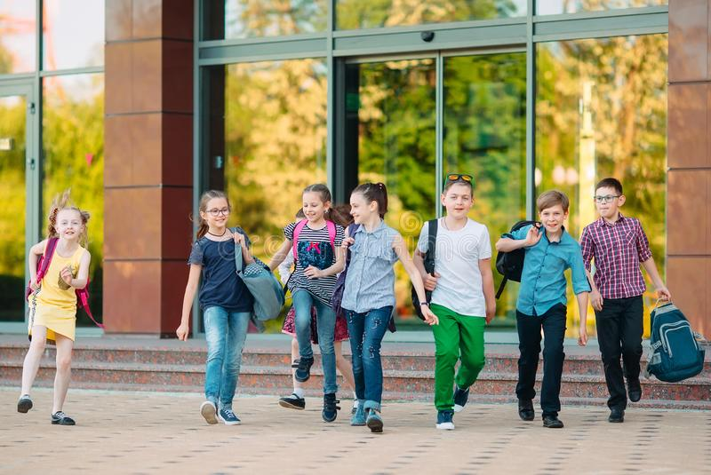 Group of kids going to school together. Group of kids going to school together stock images