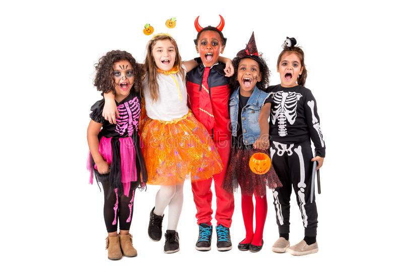 Group of kids in Halloween costumes royalty free stock photo