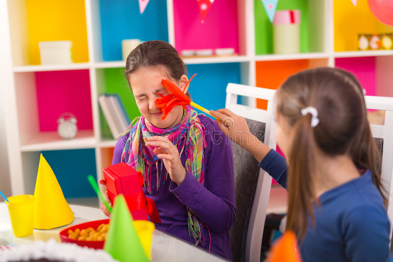 Group of kids having fun at birthday party stock image