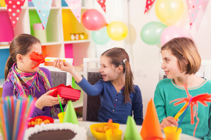 Group of kids having fun at birthday party stock photo