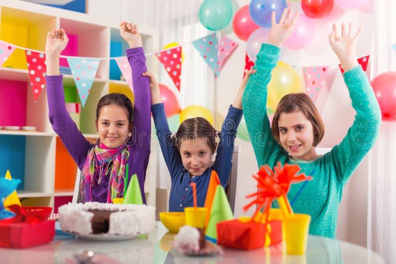 Group of kids having fun at birthday party stock photos
