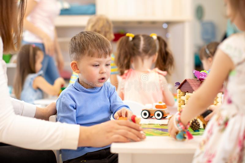 Group of kids on lesson in kindergarten stock image