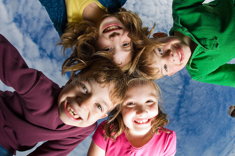Group of Kids looking down stock photos