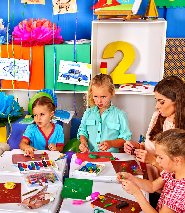 Group kids mold from plasticine in kindergarten . royalty free stock images
