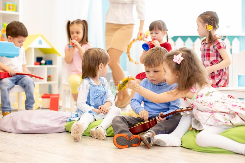 Group of kids with musical instruments in daycare stock image