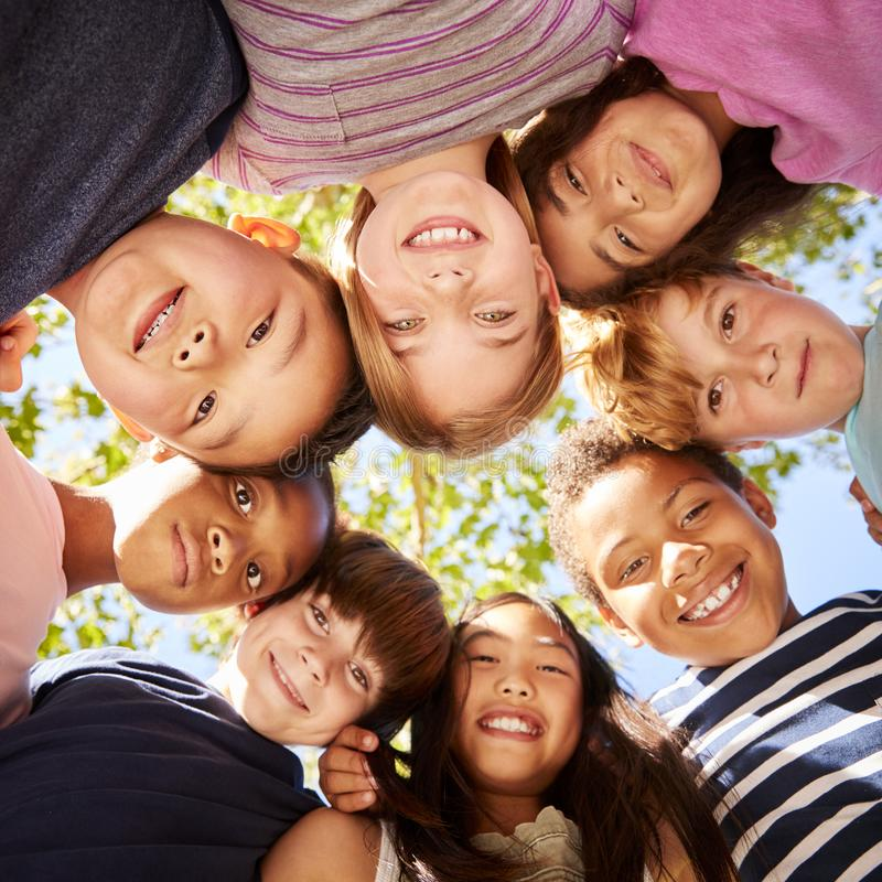 Group of kids outdoors looking down at camera, square format stock photo
