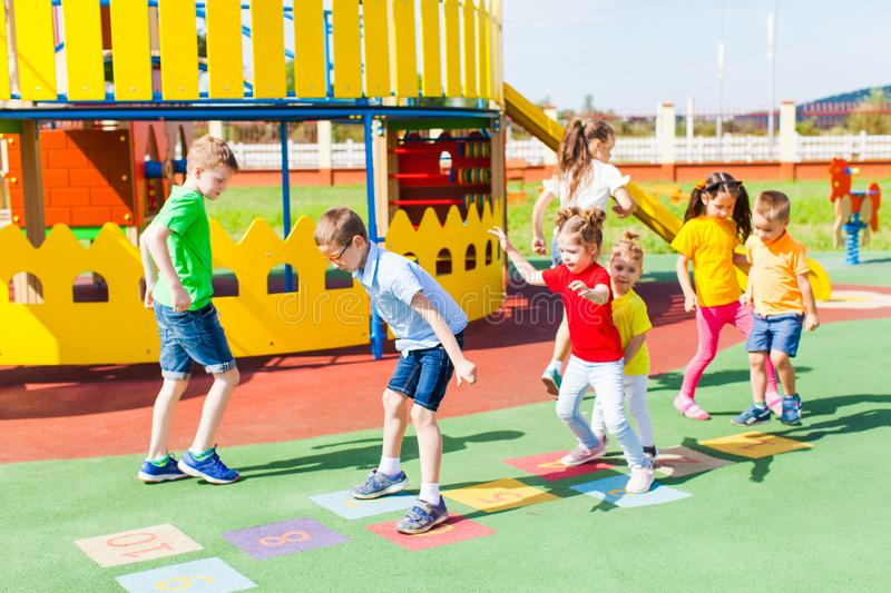 Group of kids play hopscotch stock photo