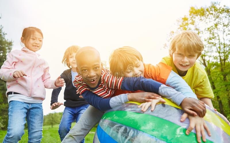 Group of kids playing ball royalty free stock photo