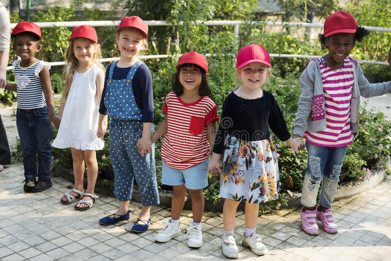 Group of kids school field trips learning outdoors botanic park stock photography