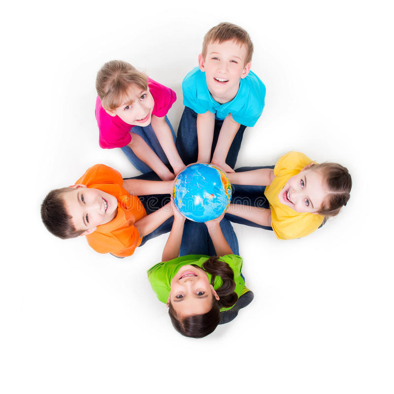 Group of kids sitting on the floor in a circle. stock images