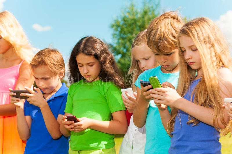 Group of kids sms stock photo