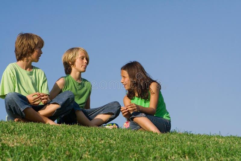 Group Of Kids Talking Stock Photos