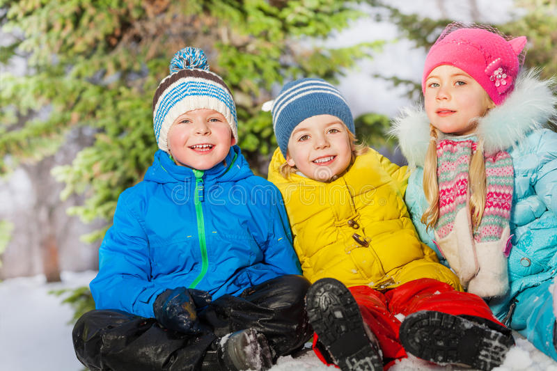 Group of kids together in the snow royalty free stock images