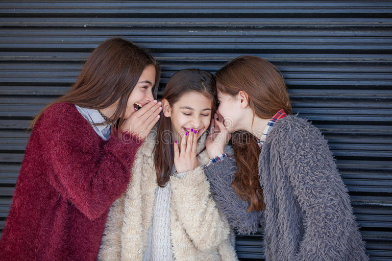 Group kids whispering secrets royalty free stock photography