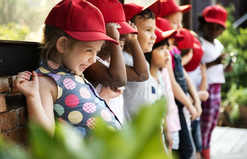 Group of kindergarten kids learning gardening outdoors field trips royalty free stock photos