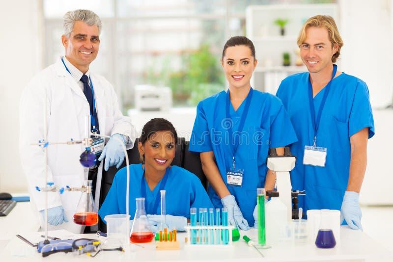 Group lab technicians stock images