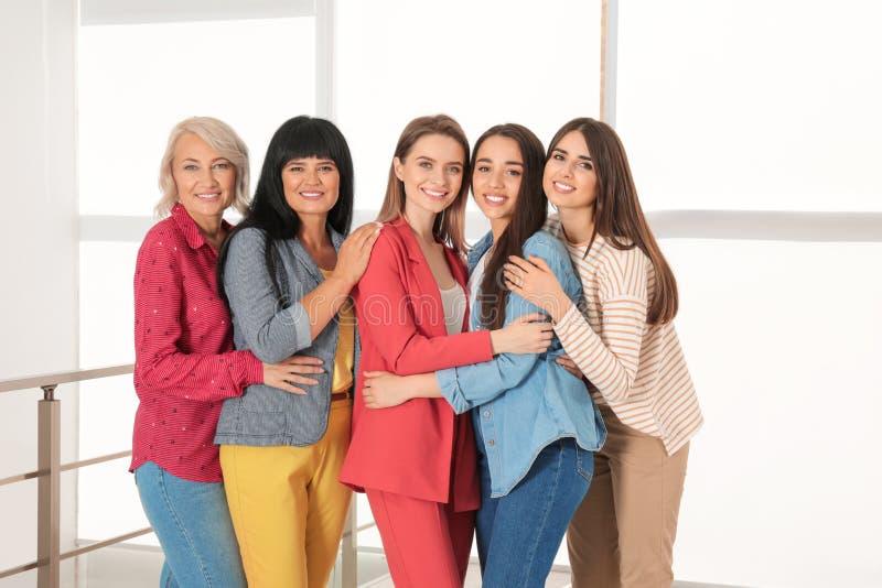 Group of ladies near window. Women power concept stock image