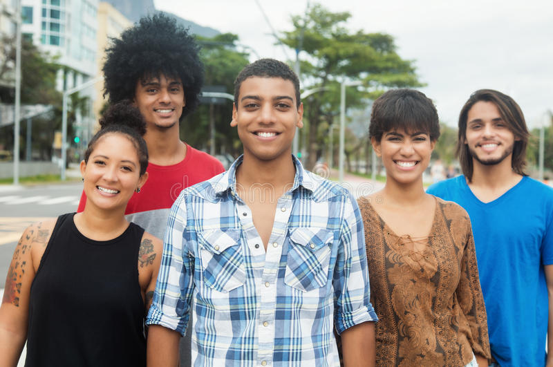 Group of laughing urban young adult people in the city. Group of laughing urban young adult people outdoor in the city royalty free stock image