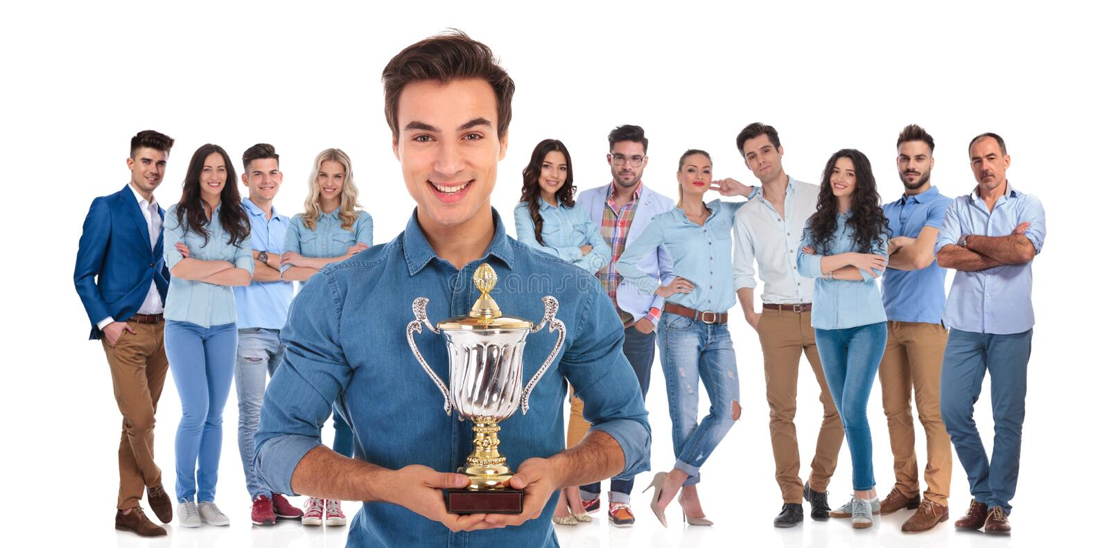 Group leader of young casual team presenting you their cup royalty free stock photography