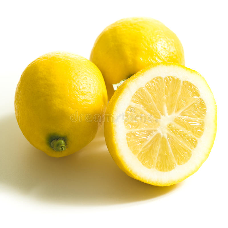 Group of lemons. Close up of lemon halves and whole on white royalty free stock photography