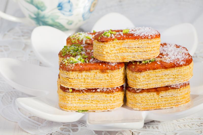 Group of Light Crunchy Puff Layered Pastry Garnished With Pistachios & Coconut Flakes Popular Persian Sweets In Iran Called. Zaboon Or Zaban royalty free stock photography