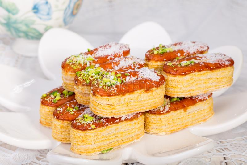 Group of Light Crunchy Puff Layered Pastry Garnished With Pistachios & Coconut Flakes Popular Persian Sweets In Iran Called. Zaboon Or Zaban royalty free stock image