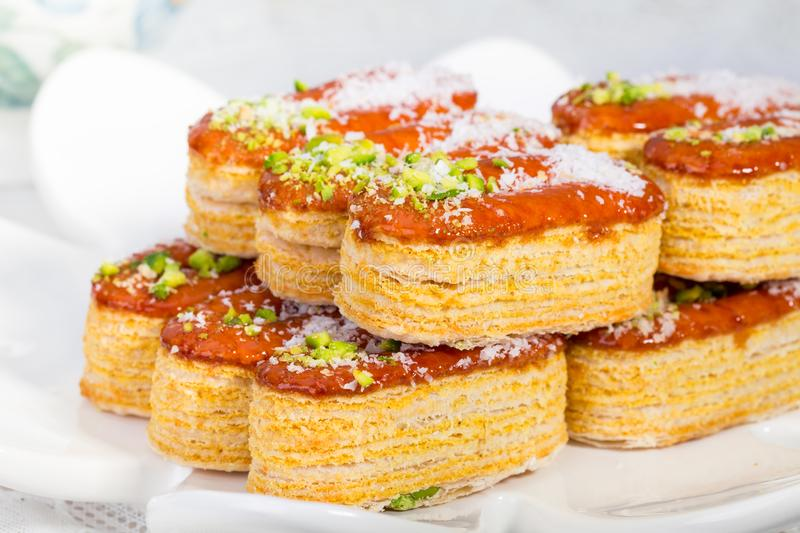 Group of Light Crunchy Puff Layered Pastry Garnished With Pistachios & Coconut Flakes Popular Persian Sweets In Iran Called. Zaboon Or Zaban royalty free stock photo