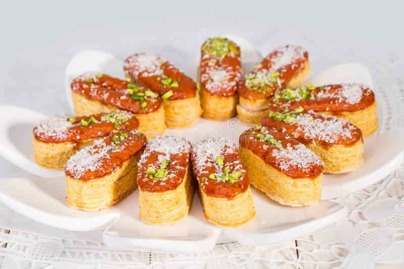 Group of Light Crunchy Puff Layered Pastry Garnished With Pistachios & Coconut Flakes Popular Persian Sweets In Iran Called. Zaboon Or Zaban royalty free stock photos