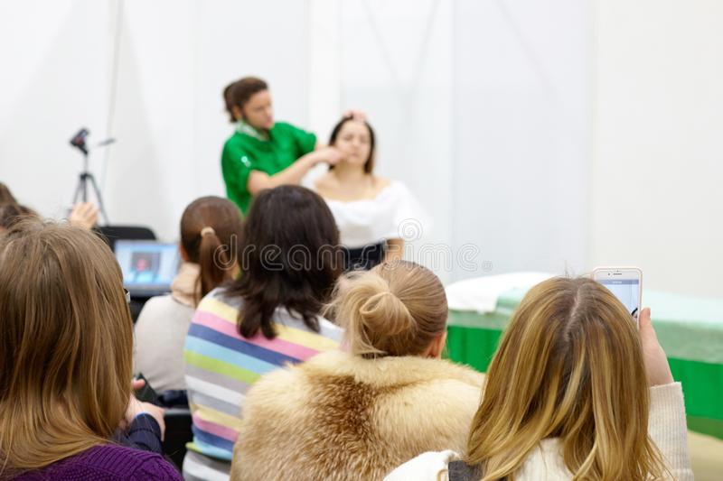A group of listeners at an exclusive massage training is being t stock images
