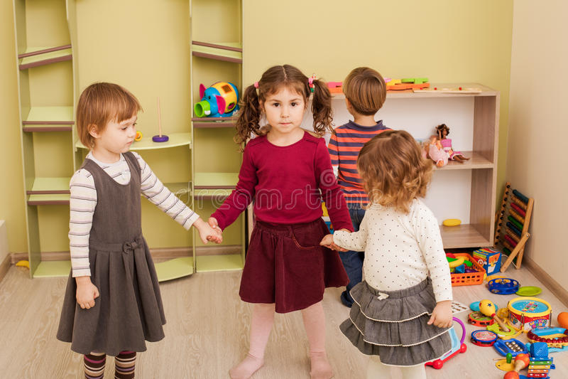 Group of little children dancing. And listening the music stock image