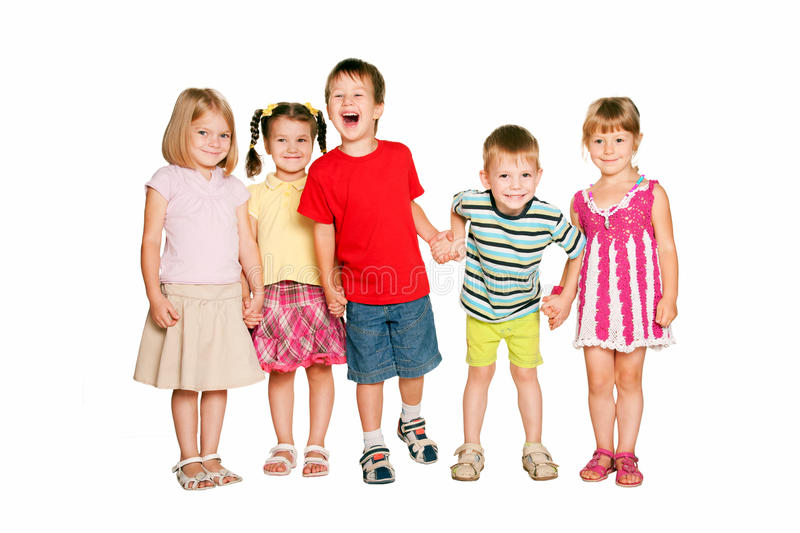 Group of little children holding hands and smiling. stock image