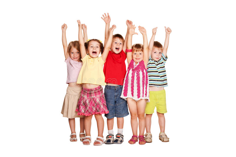 Group of little children raising hands up and smiling royalty free stock image