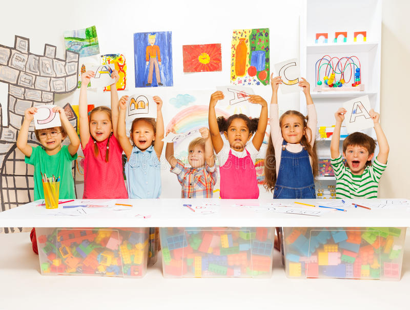 Group of little kids in early development lesson royalty free stock image