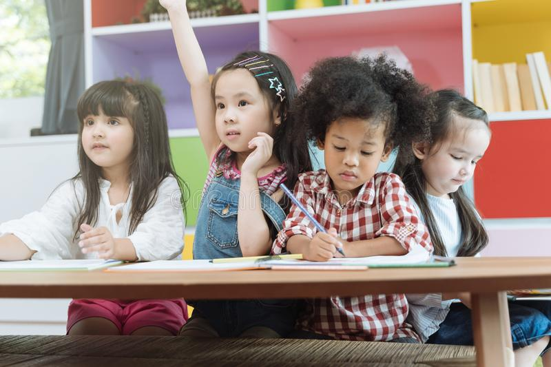 Group of little preschool kids drawing paper with color pencils . portrait of children friends education concept. Group of little preschool kids drawing paper royalty free stock photos