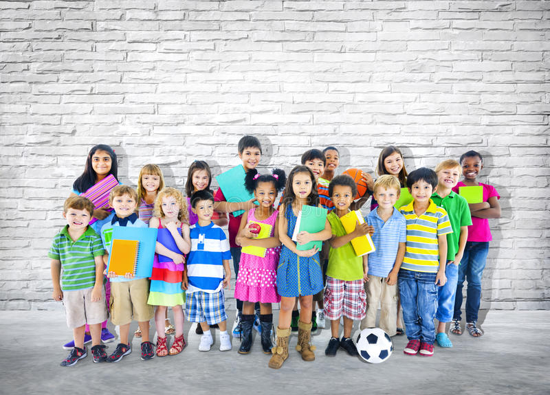 Group of Little students Standing Close to the Wall royalty free stock photography